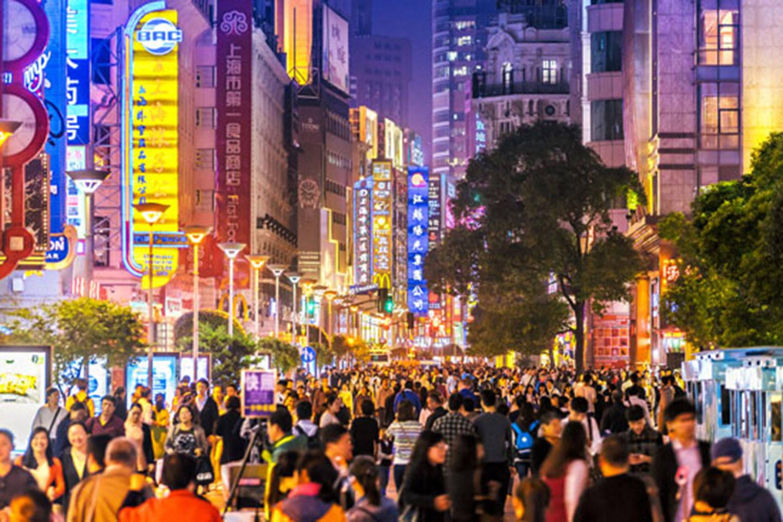Shopping crowds on nighttime street in Shanghai