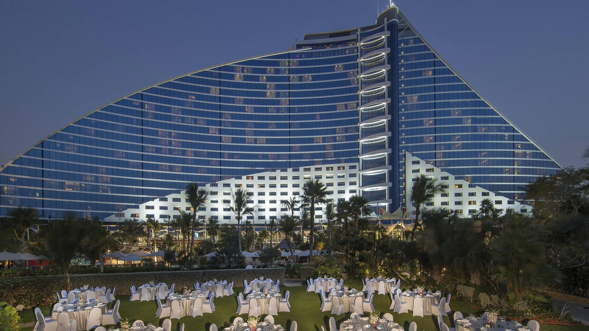 https://cdn.jumeirah.com/-/mediadh/DH/Hospitality/Jumeirah/Article/Stories/Dubai/Amazing-Venues-in-Dubai-to-Host-an-Event/Jumeirah-Beach-Hotel-Sunset-Garden-Dinner-Setup-16-9.jpg?h=1080&w=1920&hash=0D1D5C6081957500675F00FDA1D7FB3E