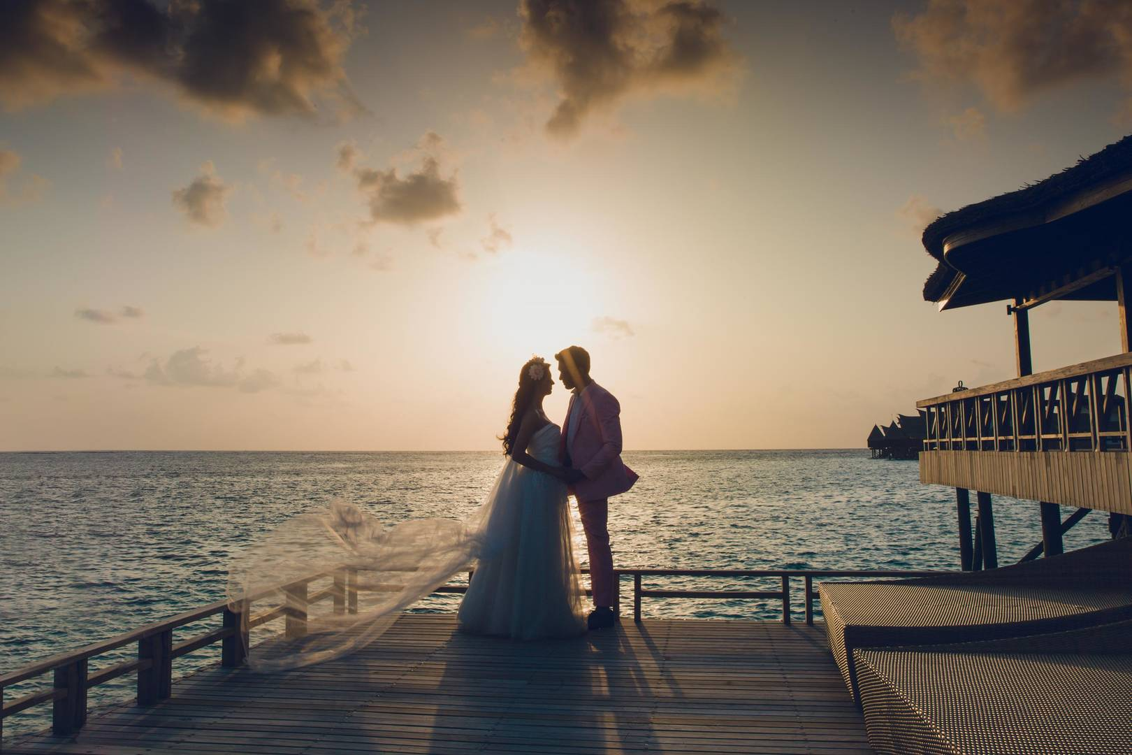 Married couple and sunset at the Jumeirah Vittaveli hotel