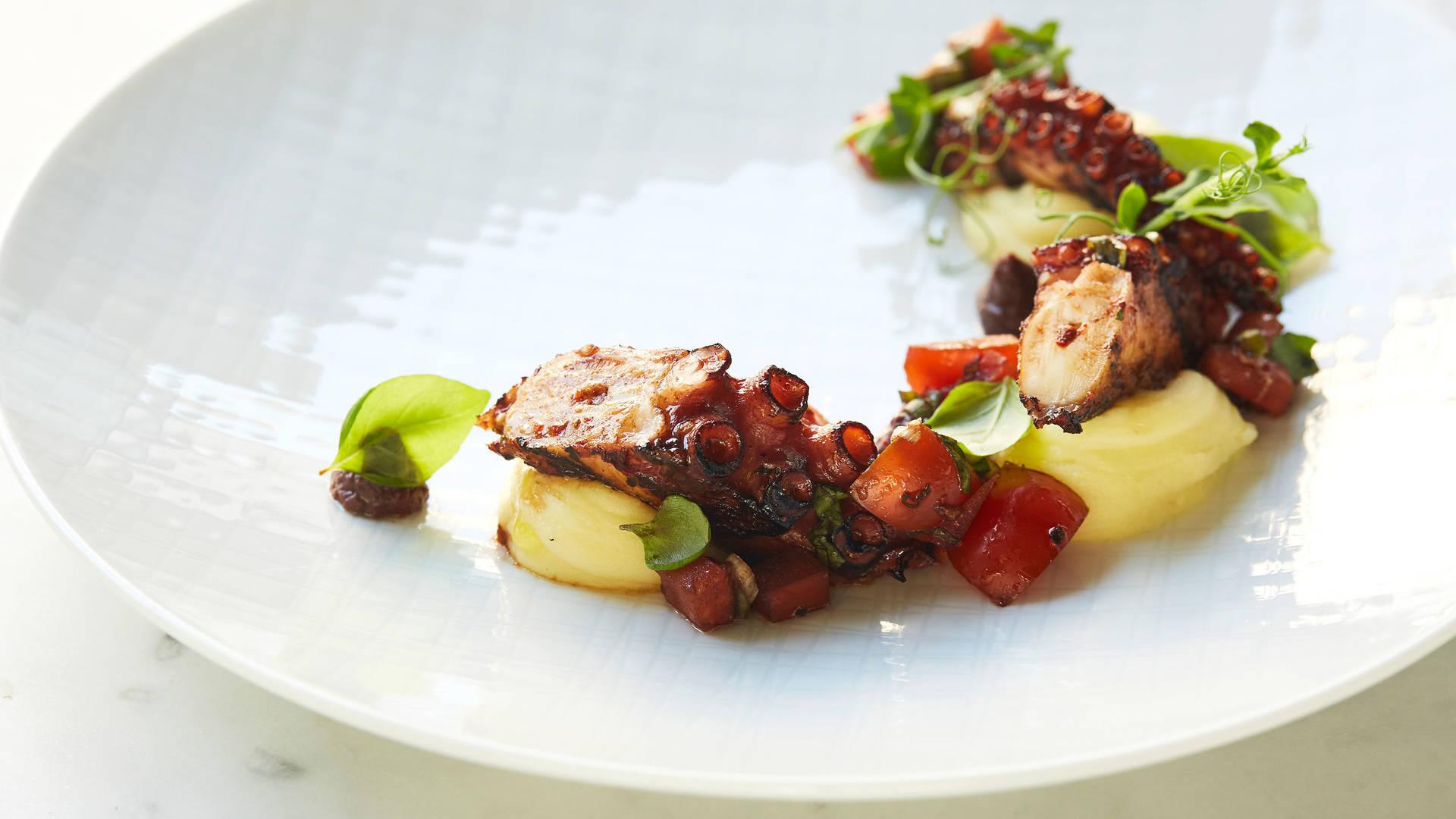 https://cdn.jumeirah.com/-/mediadh/DH/Hospitality/Jumeirah/Article/Stories/Wanderlust/Experience-Tuscany-via-Dubai/Jumeirah-Al-Naseem-Rockfish-Grilled-Octopus_16-9.jpg?h=1080&w=1920&hash=DFB7DBCA8D3785231514B0594707B787