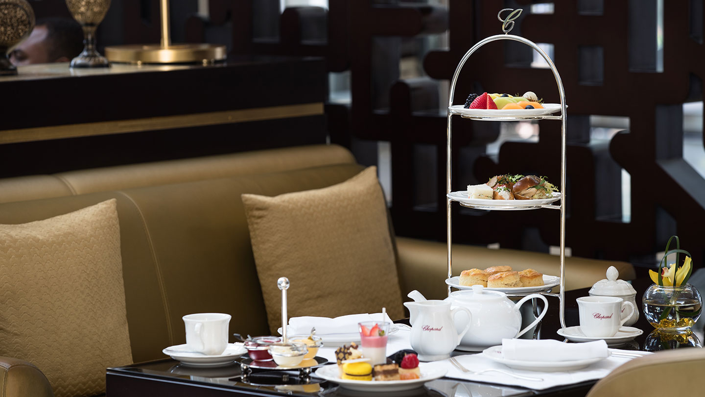 Jumeirah Emirates Towers tea and tower of cakes in luxurious setting