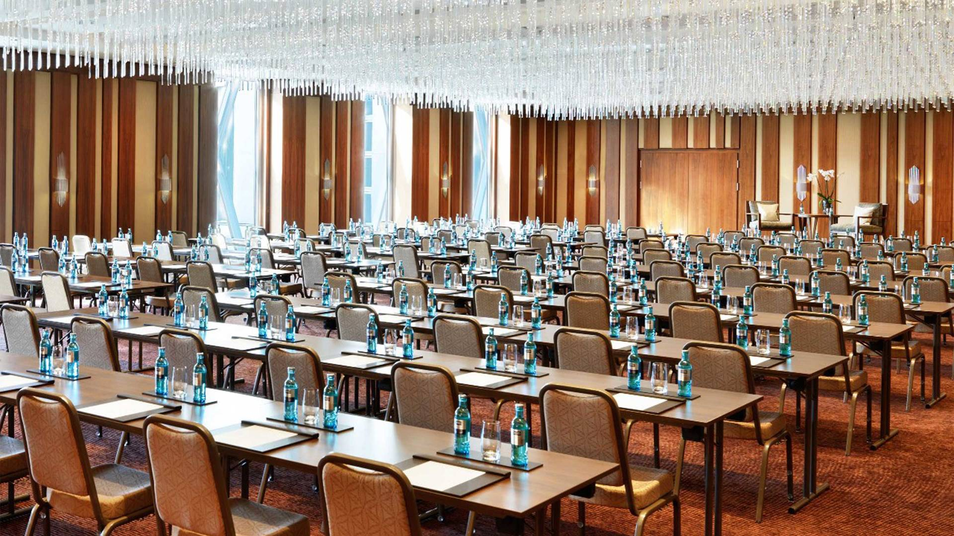 https://cdn.jumeirah.com/-/mediadh/DH/Hospitality/Jumeirah/Hotels/Frankfurt/Jumeirah-Frankfurt/Meeting-Rooms/16-9_Hero-thumbnail_Jumeirah-Frankfurt-Crystal-Ballroom-Classroom-Setup_landscape.jpg?h=1080&w=1920&hash=9951CB1FA28B973C8129E8BBB639A611