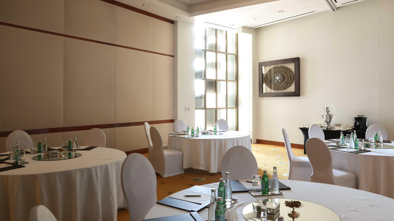 https://cdn.jumeirah.com/-/mediadh/DH/Hospitality/Jumeirah/Hotels/Kuwait/Jumeirah-Messilah-Beach-Hotel-and-Spa/Meeting-Rooms/Dewan/169DewanMeetingRoomtables-JumeirahMessilahBeachHotelSpa3_landscape.jpg?h=1620&w=2880&hash=9C9A20A37A67754A4CB844DAC03DCB85