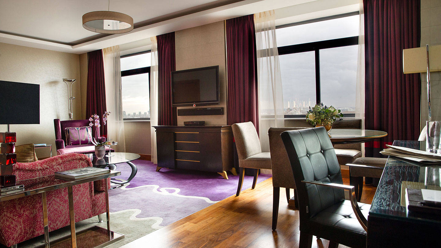 Desk and living area of suite at Jumeirah Carlton Tower