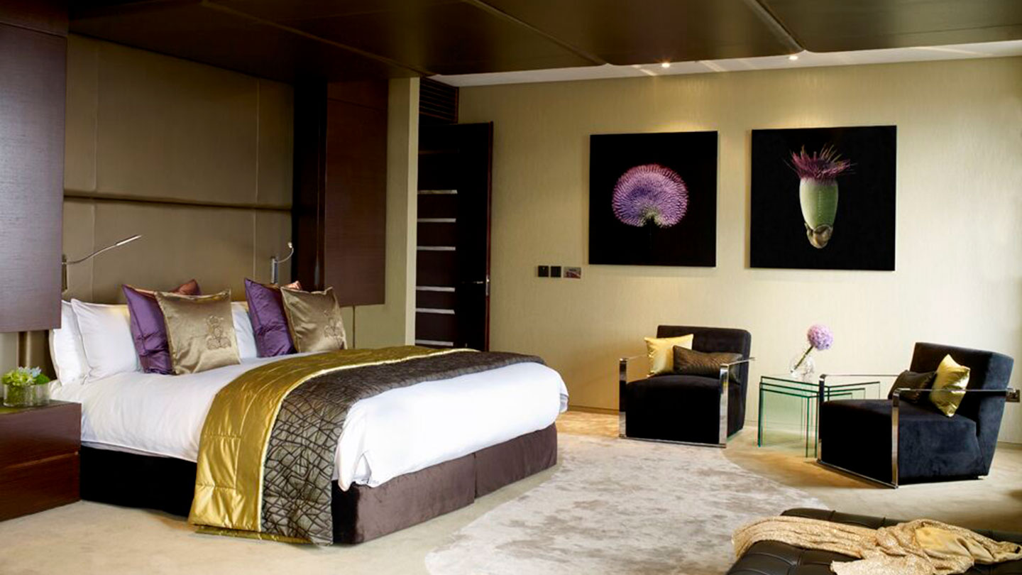 Luxurious bedroom and chairs at Jumeirah Carlton Tower