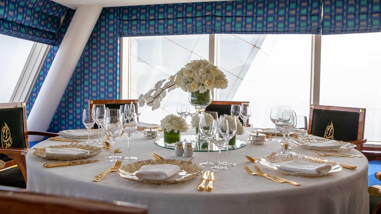 https://cdn.jumeirah.com/-/mediadh/DH/Hospitality/Jumeirah/Occasion/Dubai/Burj-Al-Arab/Suha-Boardroom/16-9_Burj-Al-Arab-Jumeirah-Suha-Boardroom-Banquet-Table-Setup-table-deco.jpg?h=1620&w=2880&hash=1730098A506B8420088C4406CBFDB533