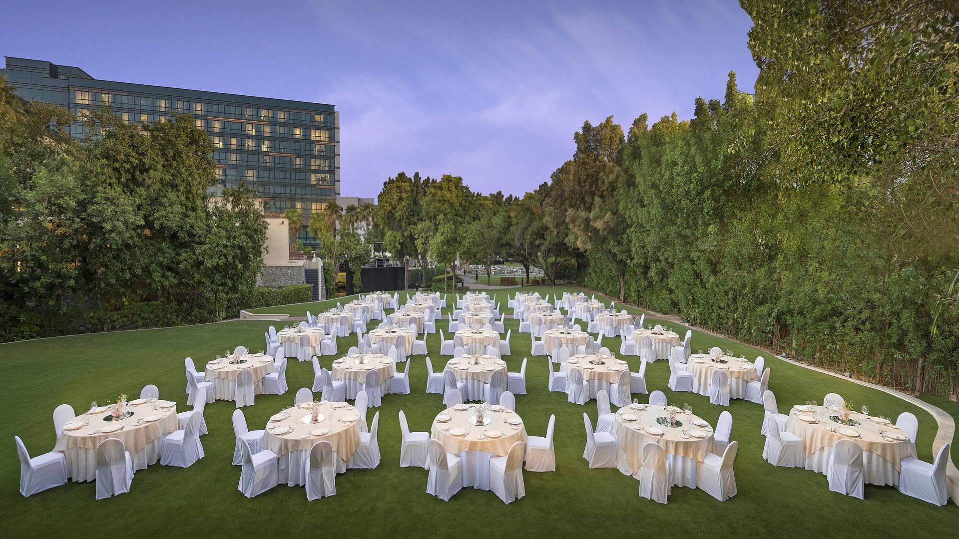 https://cdn.jumeirah.com/-/mediadh/DH/Hospitality/Jumeirah/Occasion/Dubai/Creekside-Hotel/Creekside-Hotel-Gardens/Jumeirah-Creekside-Hotel-Secret-Garden-Dinner-Set-Up-Evening16-9.jpg?h=1080&w=1920&hash=1A1D35D97AB23CE6BCA87280C149877F