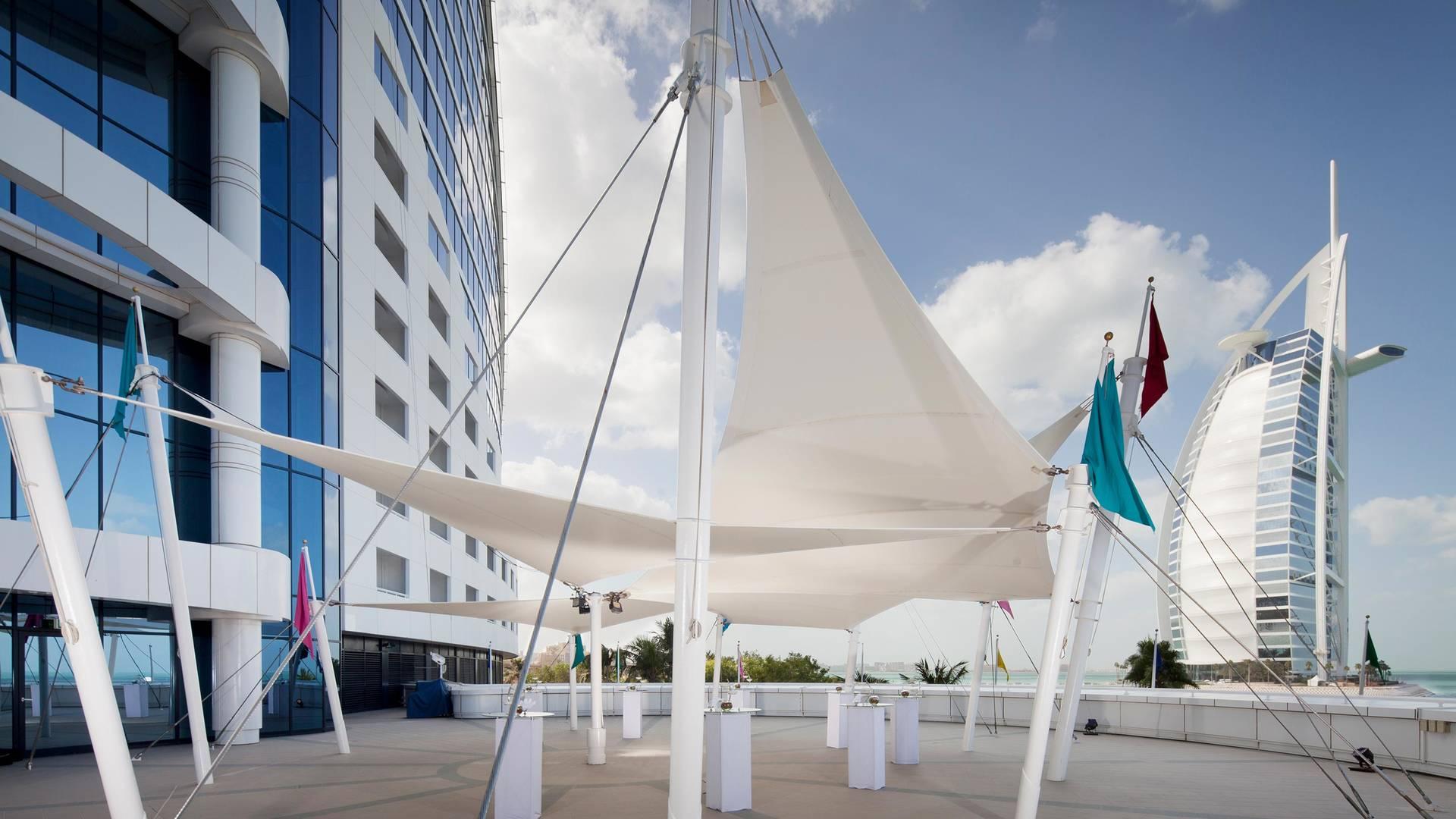 https://cdn.jumeirah.com/-/mediadh/DH/Hospitality/Jumeirah/Occasion/Dubai/Jumeirah-Beach-Hotel/Sundeck/Jumeirah-Beach-Hotel-Sundeck-Events-Area_16-9.jpg?h=1080&w=1920&hash=878A6FD9257AA399B119E8D33477C9B8