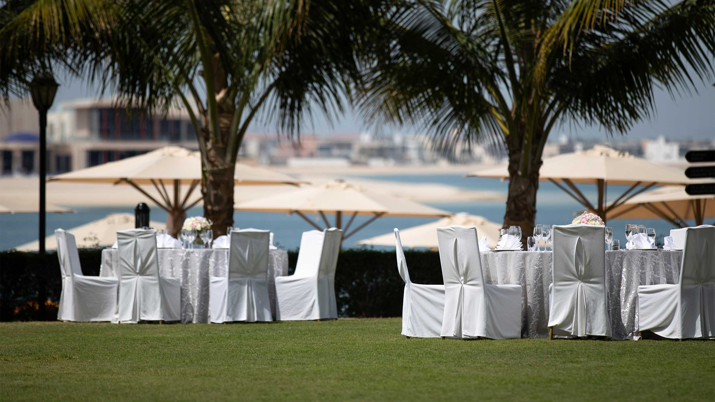 https://cdn.jumeirah.com/-/mediadh/DH/Hospitality/Jumeirah/Occasion/Dubai/Zabeel-Saray/Beach-wedding/16-9_Jumeirah-Zabeel-Saray-Events-Exterior-table.jpg?h=1620&w=2880&hash=2D57077A5FD1C9CC7999A173AB09A467