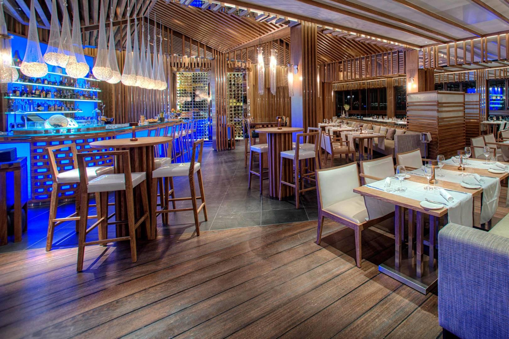 https://cdn.jumeirah.com/-/mediadh/DH/Hospitality/Jumeirah/Restaurants/Dubai/Al-Qasr-Pierchic/Hero-Banner/Madinat-Jumeirah-Al-Qasr-Pierchic-Interior_6-4.jpg?h=1080&w=1620&hash=7885011BA745FA4624D9F700AE1FFB9F