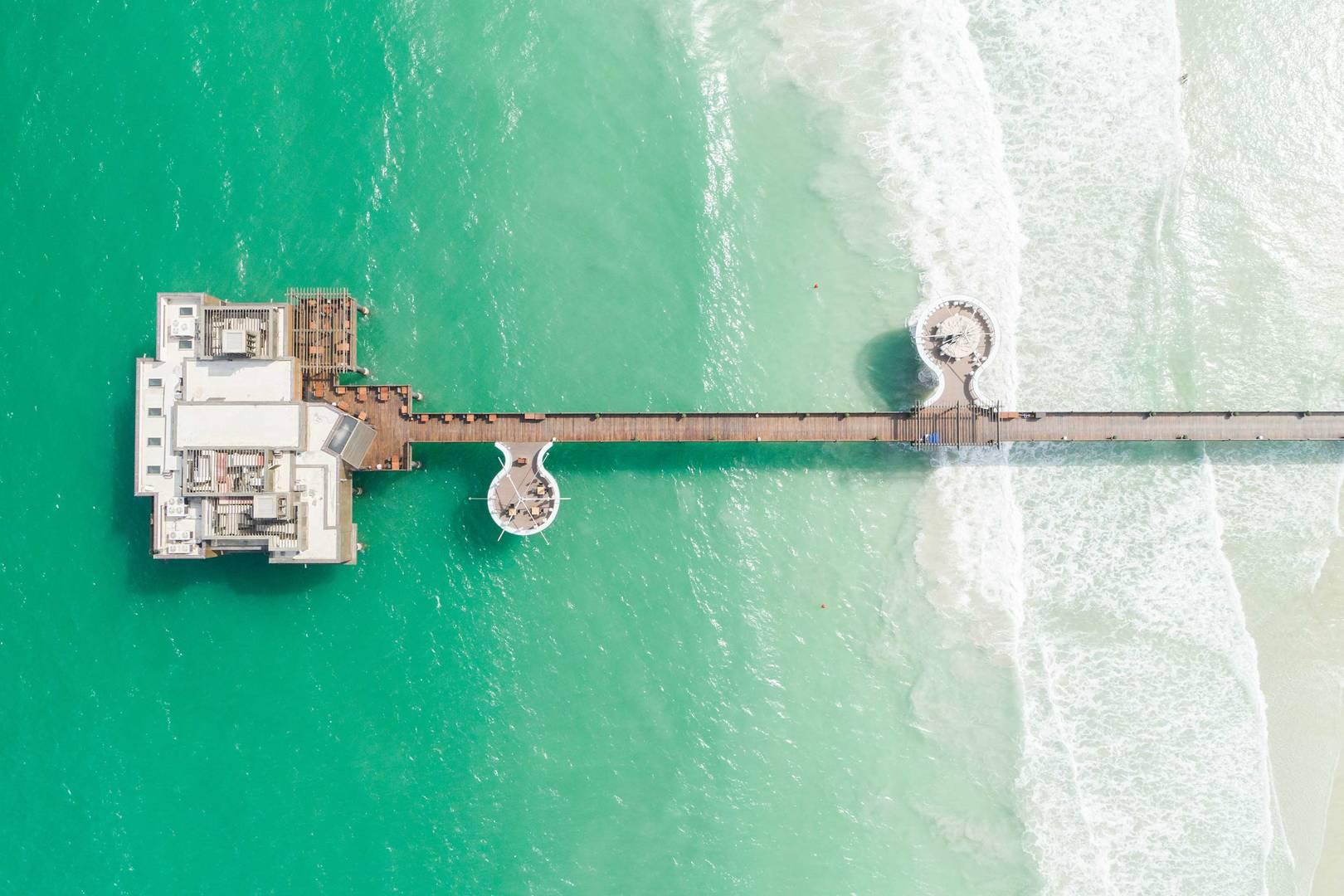 https://cdn.jumeirah.com/-/mediadh/DH/Hospitality/Jumeirah/Restaurants/Dubai/Al-Qasr-Pierchic/Restaurant-Gallery/Jumeirah-Al-Qasr-Pierchic-Aerial-Drone_6-4.jpg?h=1080&w=1620&hash=31B2E8B6E31508AE11FA831A3F3F31E4