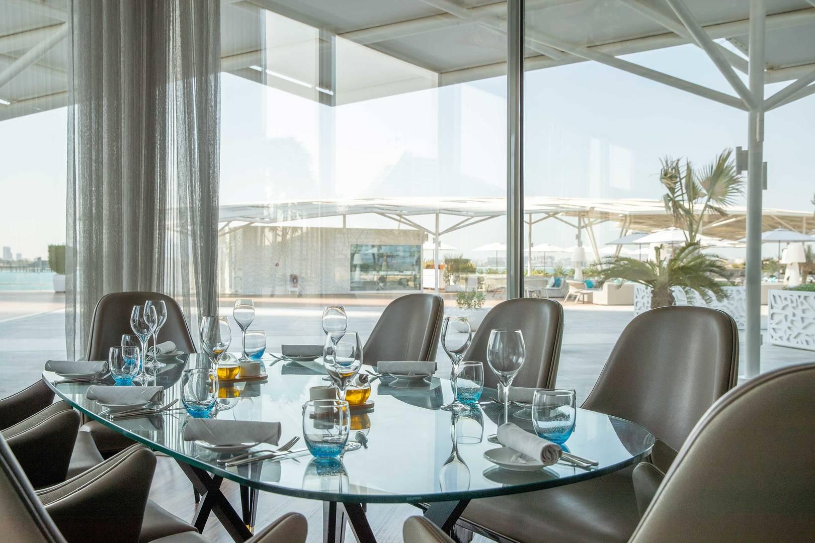 https://cdn.jumeirah.com/-/mediadh/DH/Hospitality/Jumeirah/Restaurants/Dubai/Buj-Al-Arab-Scape-restaurant-and-lounge/Restaurant-Gallery/Burj-Al-Arab-Scape-Window-Seat-6-4.jpg?h=1080&w=1620&hash=A1BF5FBD22E2411E73752D18C55D6C11