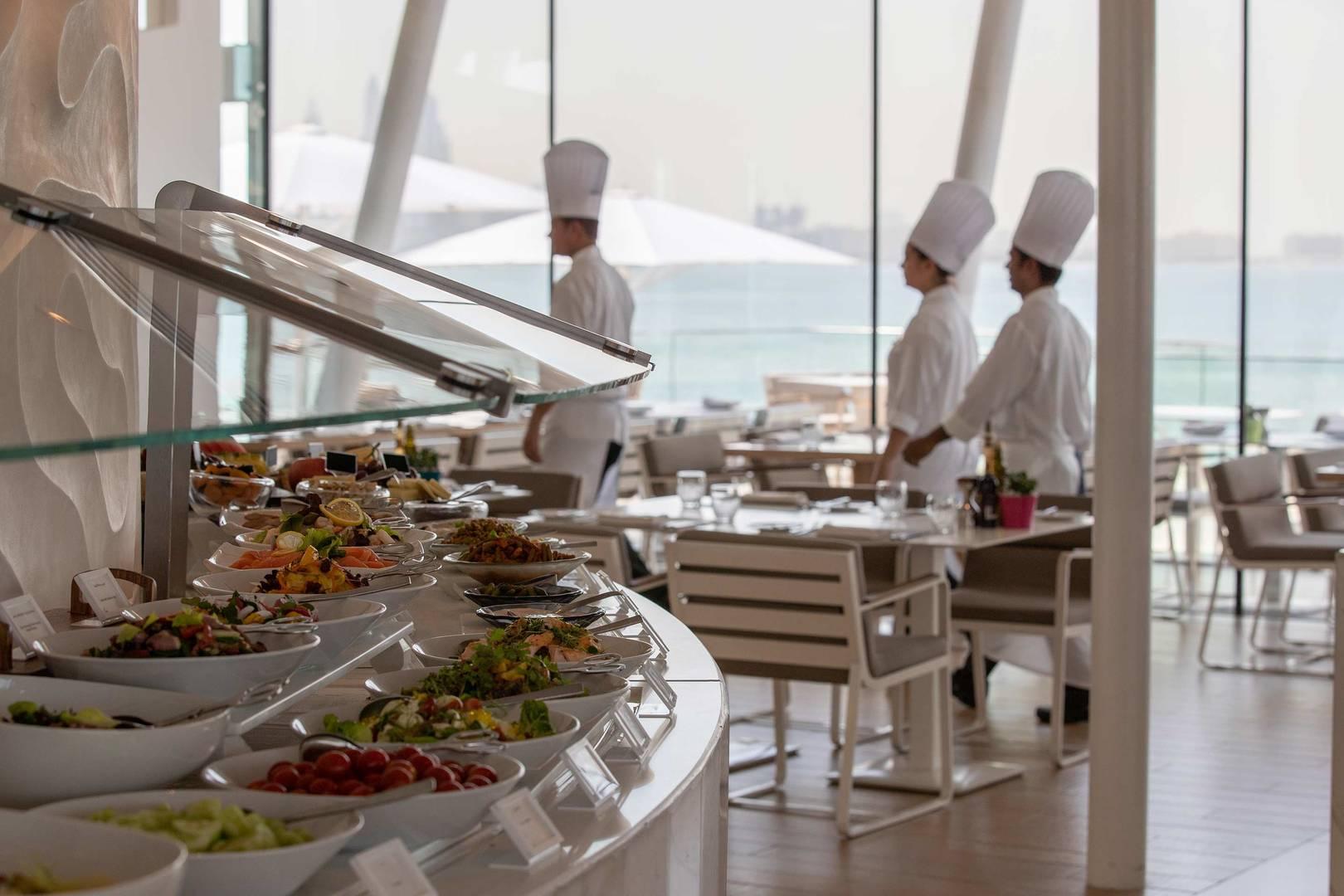 https://cdn.jumeirah.com/-/mediadh/DH/Hospitality/Jumeirah/Restaurants/Dubai/Burj-Al-Arab-Bab-Al-Yam/Restaurant-Gallery/Burj-Al-Arab-Bab-Al-Yam-Buffet_6-4.jpg?h=1080&w=1620&hash=78CF0FDF87772159E16D0B642577EAB0