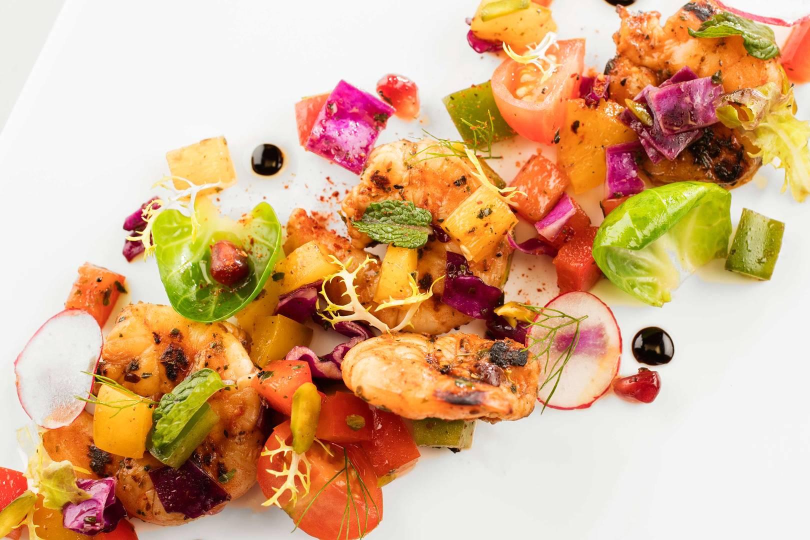 https://cdn.jumeirah.com/-/mediadh/DH/Hospitality/Jumeirah/Restaurants/Dubai/Burj-Al-Arab-Bab-Al-Yam/Restaurant-Gallery/Burj-Al-Arab-Restaurants-Bab-Al-Yam-Cajun-Spiced-Prawns-Salad_6-4.jpg?h=1080&w=1620&hash=EED2FB03E2BA7B078C5CC5E09ECE4AF5