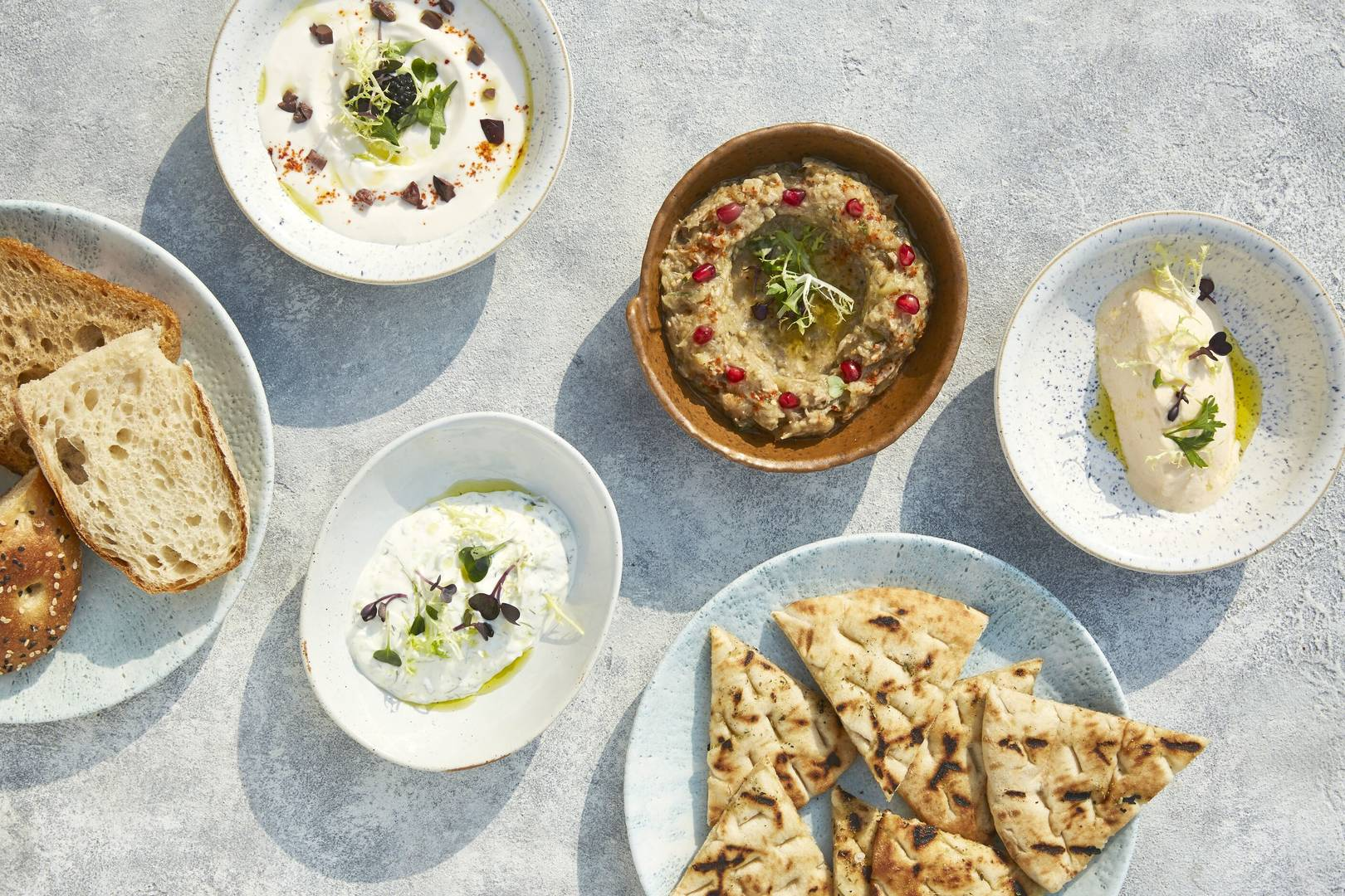 https://cdn.jumeirah.com/-/mediadh/DH/Hospitality/Jumeirah/Restaurants/Dubai/Mina-A-Salam-Shimmers/Restaurant-Gallery/Jumeirah-Mina-ASalam--Shimmers--Sharing-DipsLandscape.jpg?h=1080&w=1620&hash=C0F937B66291A1BA38FD604920A441F2