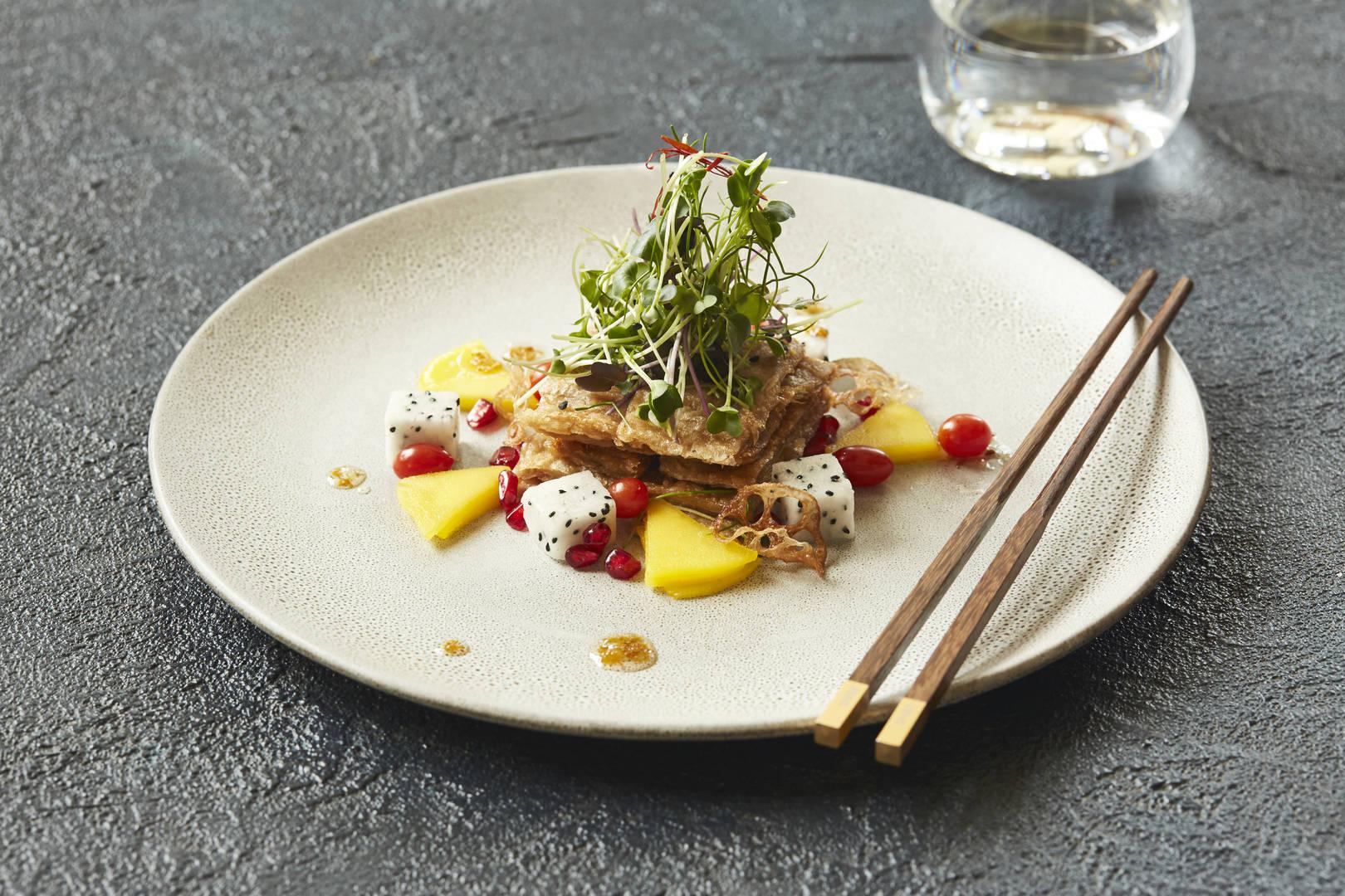 https://cdn.jumeirah.com/-/mediadh/DH/Hospitality/Jumeirah/Restaurants/Dubai/Mina-A-Salam-Zheng-Hes/Restaurant-Gallery/Jumeirah-Mina-ASalam--Zheng-Hes--Crispy-Bean-Curd-Salad--Landscape.jpg?h=1080&w=1620&hash=E2D3DEABB32E493AA3C11D43DC445C03