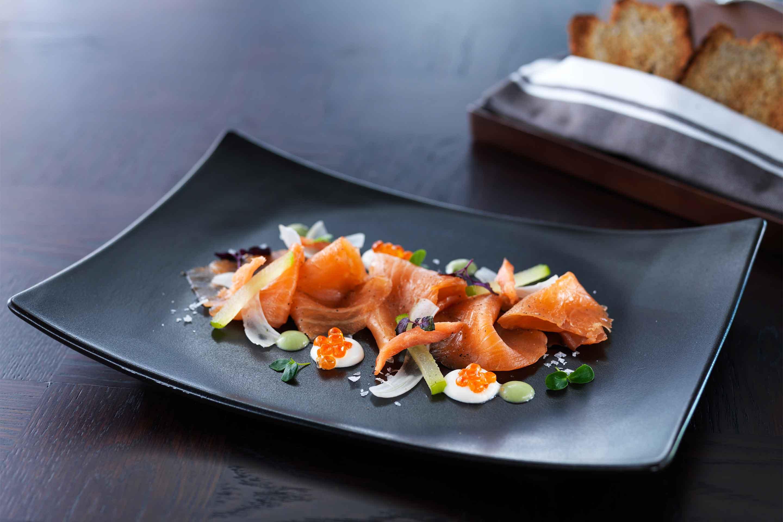 https://cdn.jumeirah.com/-/mediadh/DH/Hospitality/Jumeirah/Restaurants/Dubai/Zabeel-Saray-The-Rib-Room/Restaurant-Gallery/6-4_Jumeirah-Zabeel-Saray-The-Rib-Room-Smoked-Salmon.jpg?h=1920&w=2880&hash=19CCE104D8506EAF2517931653EB42A0