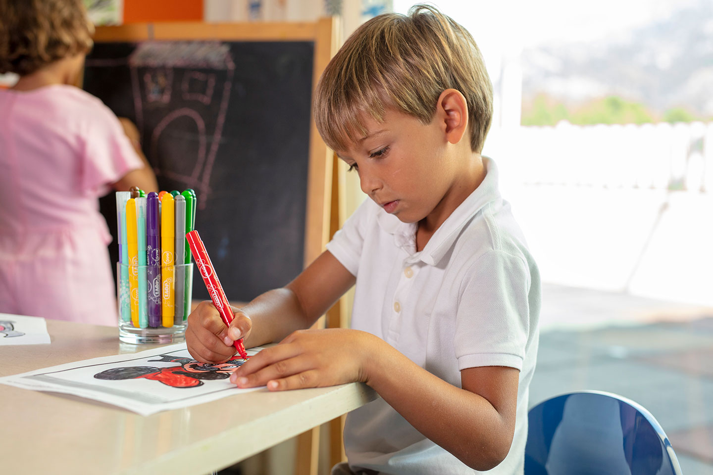 Child coloring at Jumeirah Port Soller Hotel & Spa