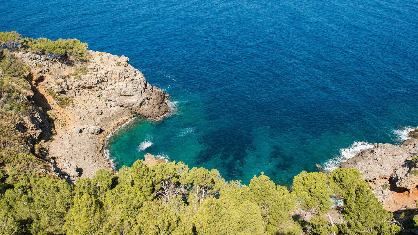 Aerial view of cliffside and blue seas