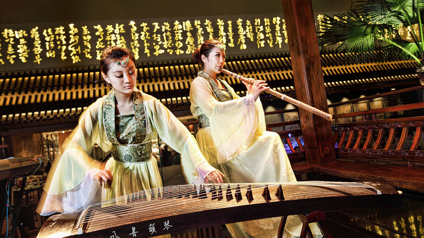 Women playing traditional Chinese instruments