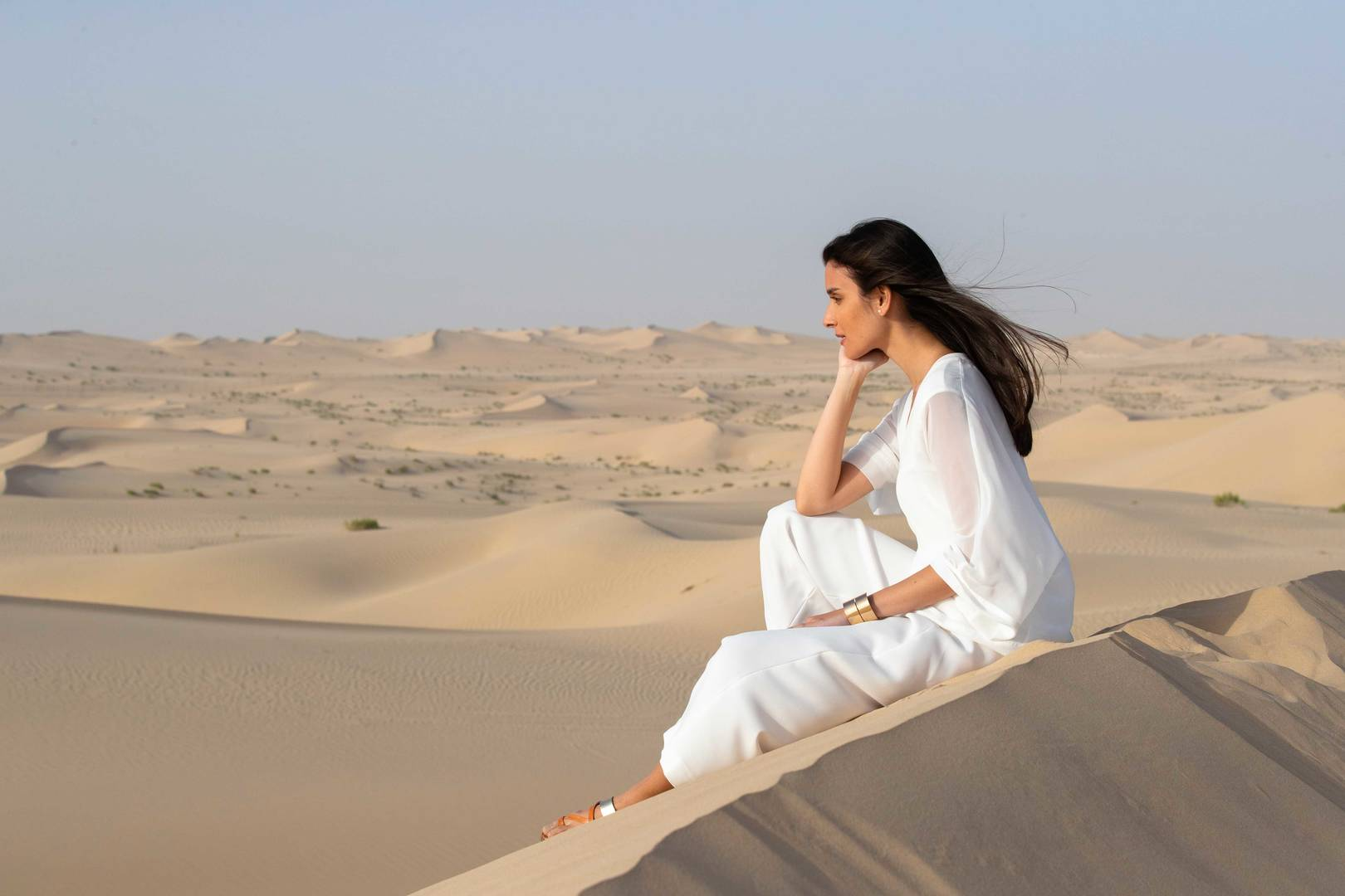 Lady sitting on the dune