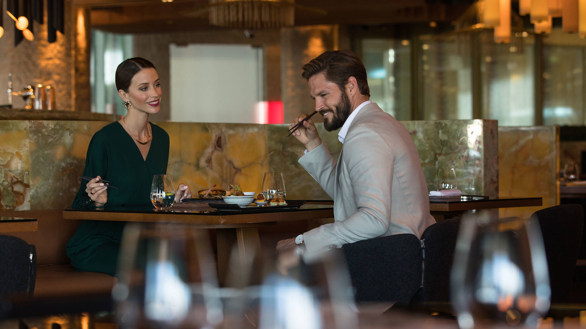 Couple in the Tori No Su Restaurant at Jumeirah Etihad Towers