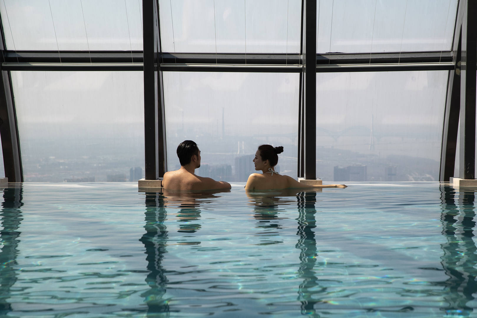 Jumeirah nanjing lifestyle couple in the pool