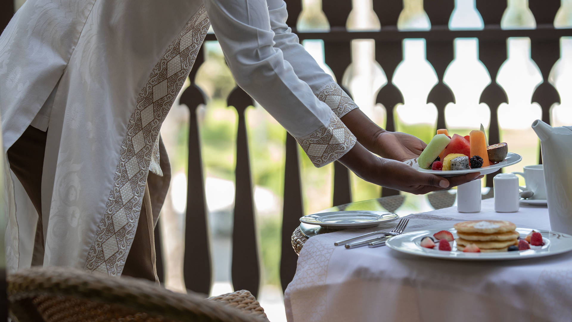 Lady serving the breakfast at Jumeirah Dar Al Masyaf hotel