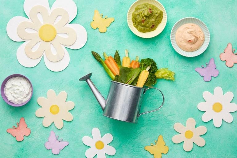 Watercan flowers vegetables