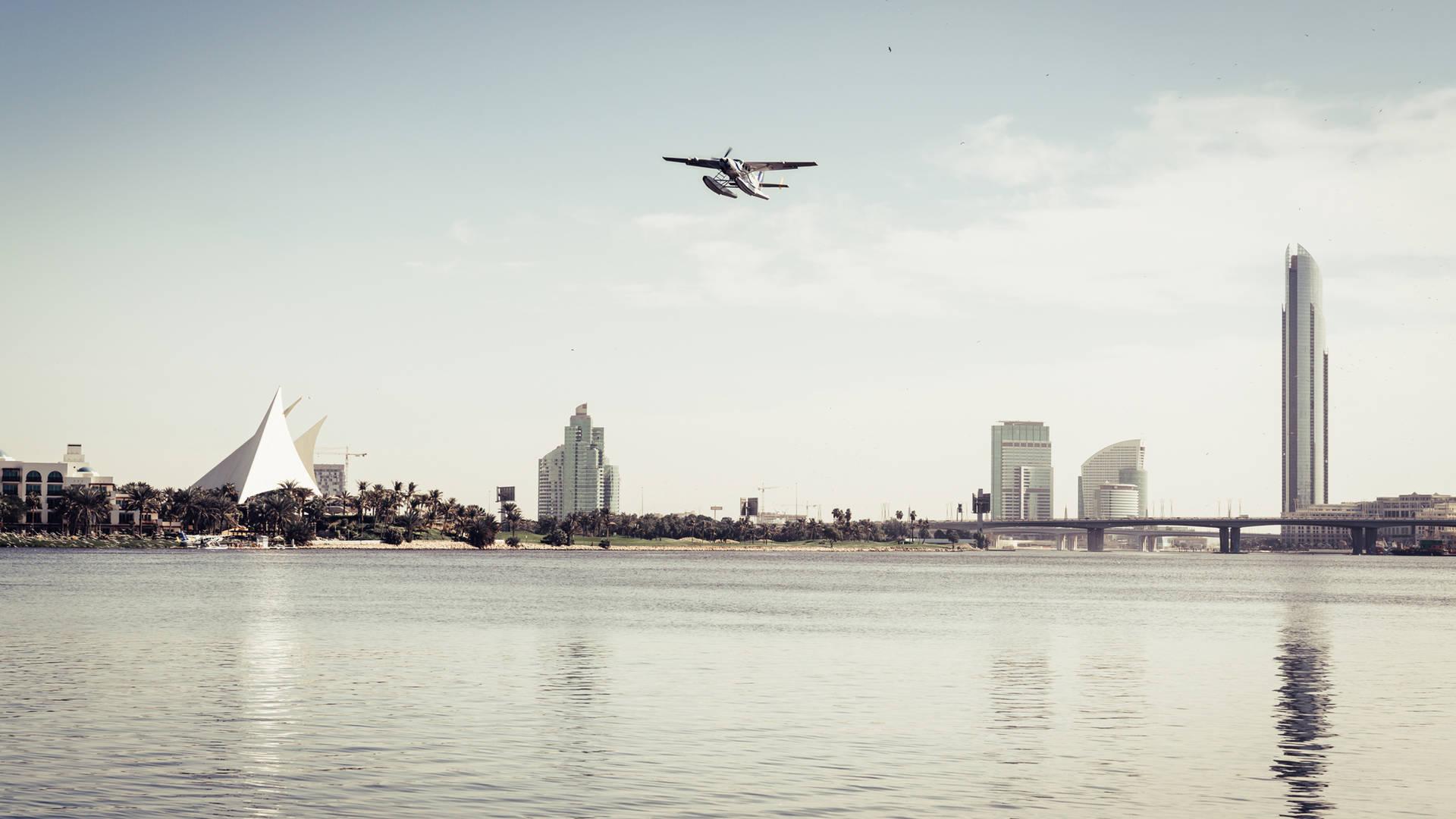 Seaplane taking off over Dubai creek