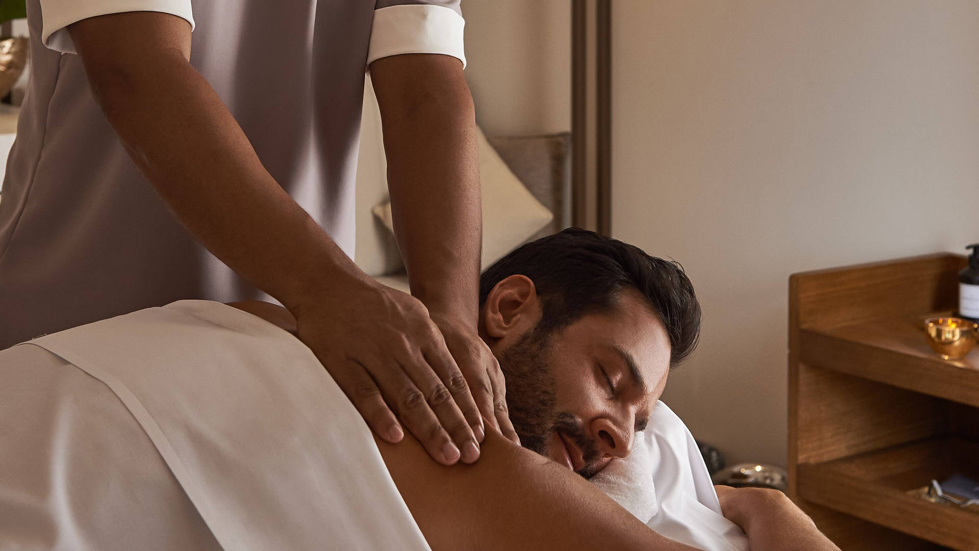 A man having a massage at Talise Spa