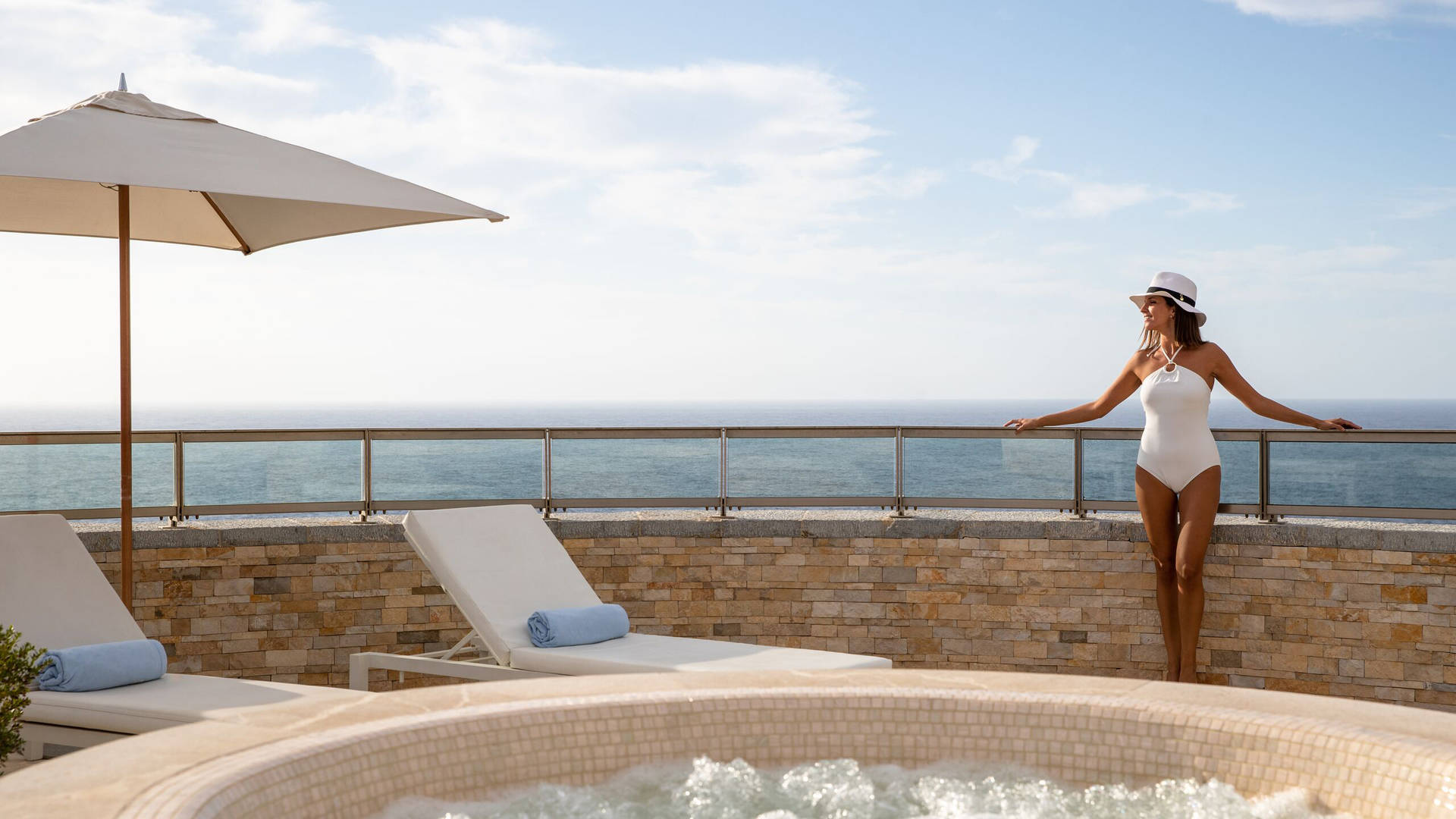 Woman on the terrace at Jumeirah Port Soller