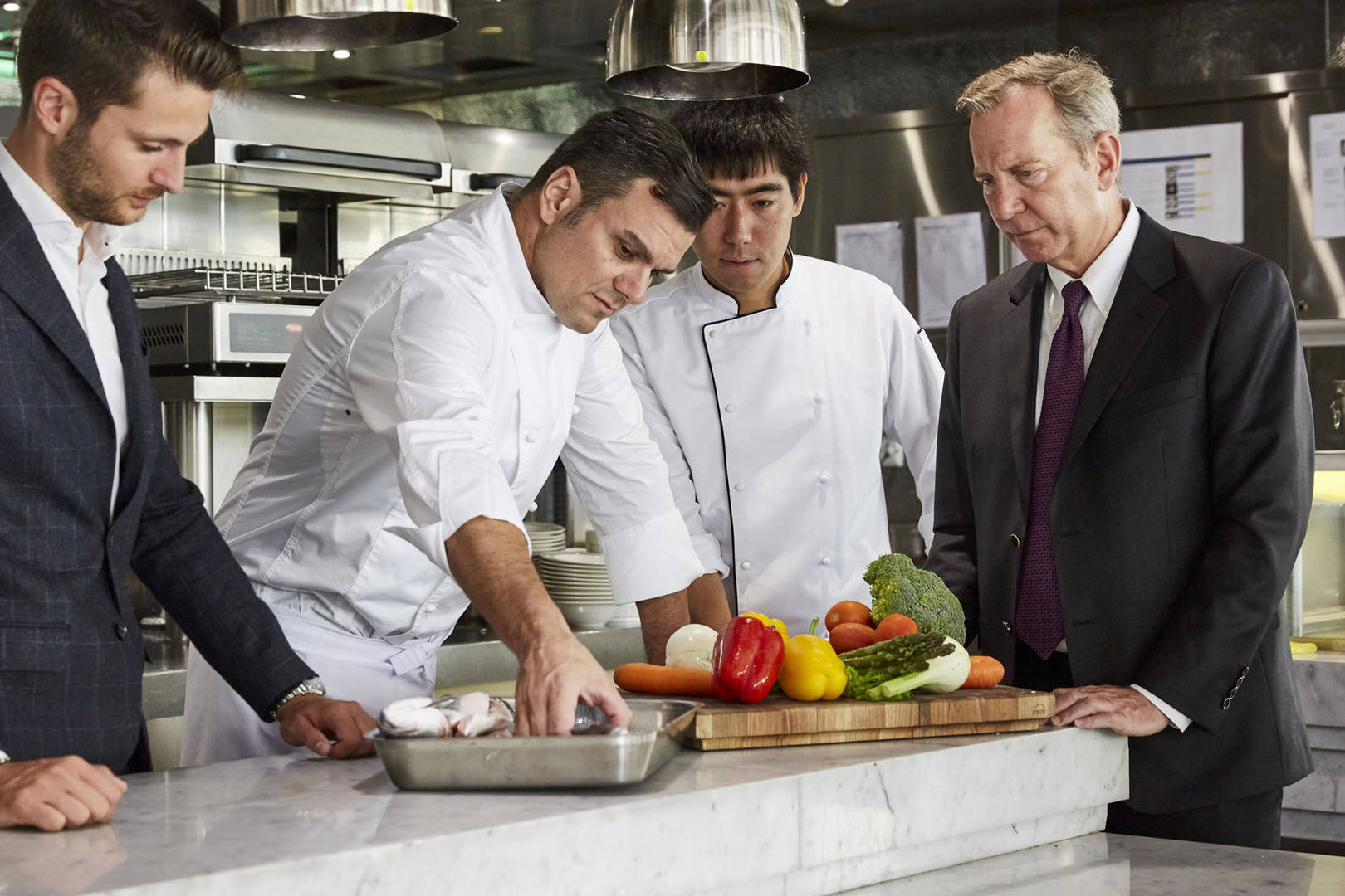 Michael Ellis in the kitchen with chefs
