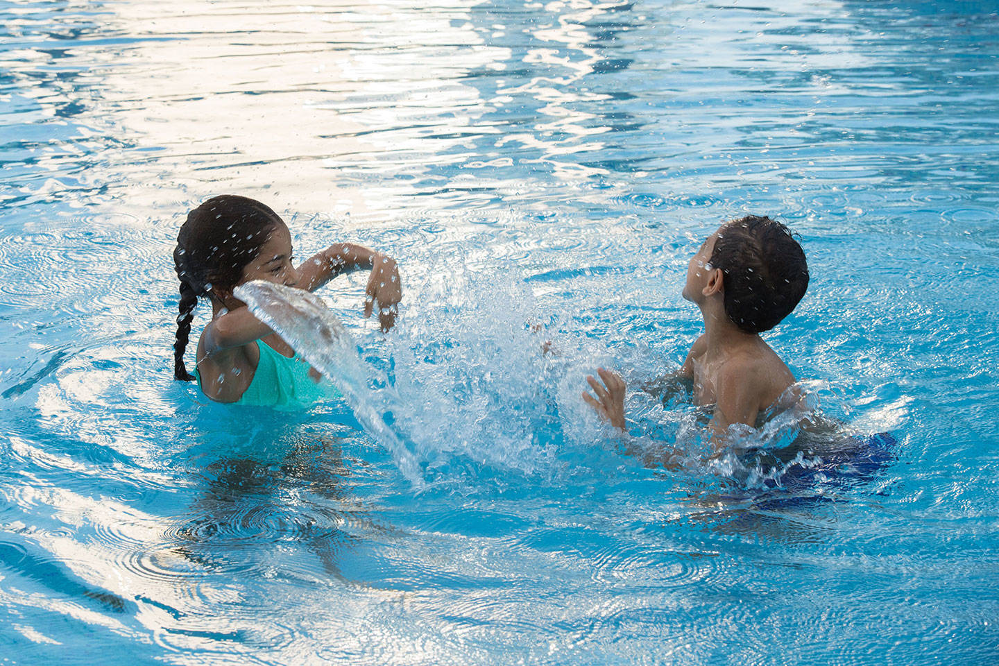 Kids splashing in pool at Jumeirah Beach Hotel