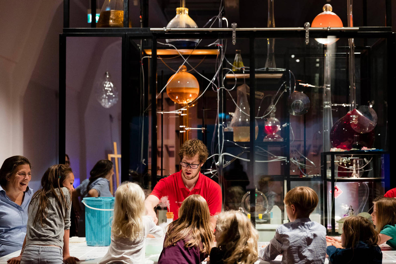 London Science museum kids having fun doing an activity
