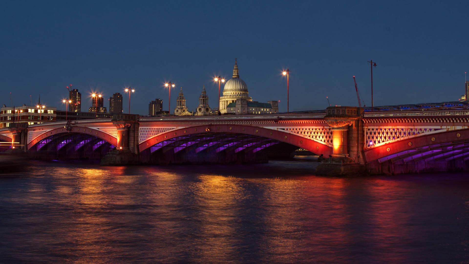 Illuminated Thames River at night London
