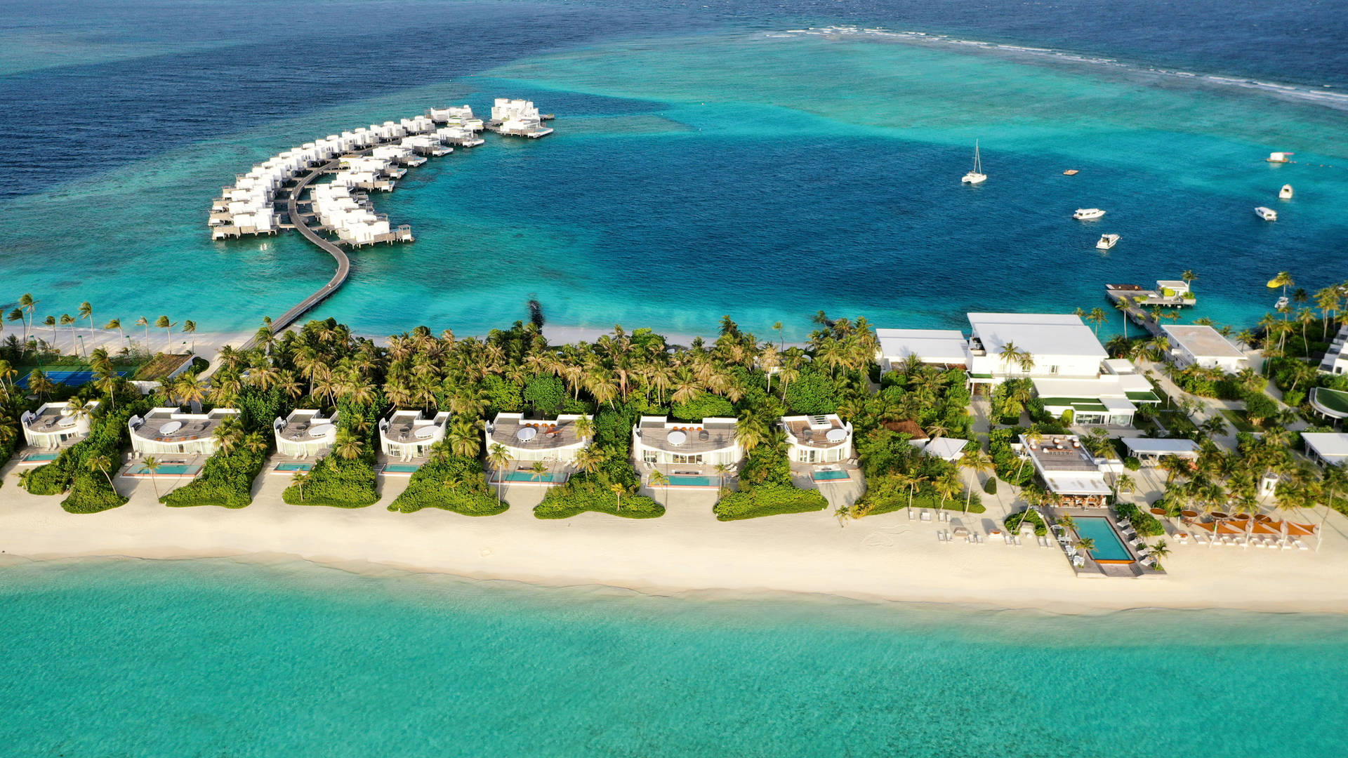 Aeiral view of the private white-sand beach at Jumeirah Maldives