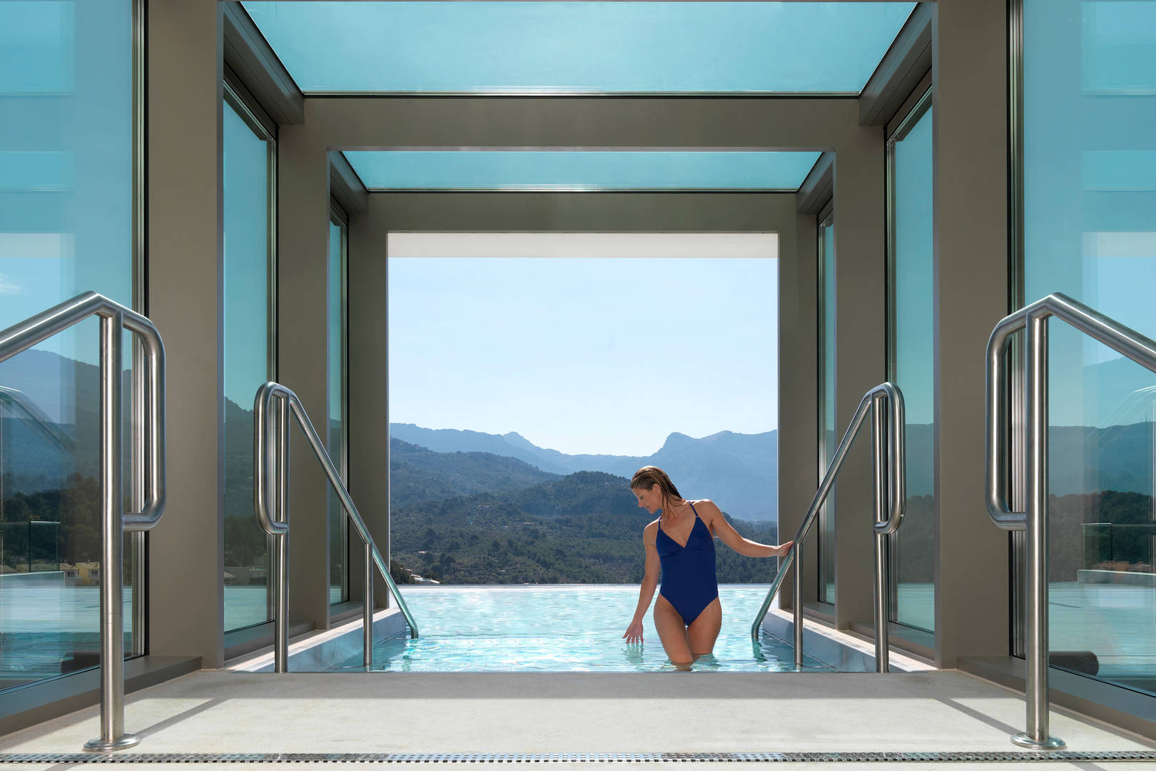 Jumeirah Port soller wellness guide, woman walking out of pool_6-4