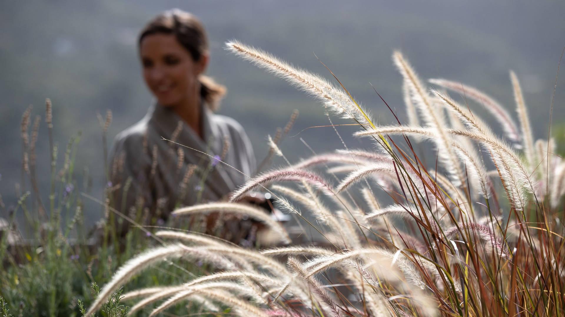A woman walking in a field