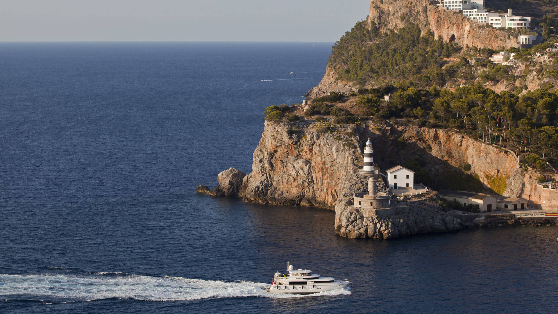 Jumeirah Port Soller Hotel Spa boat and lighthouse