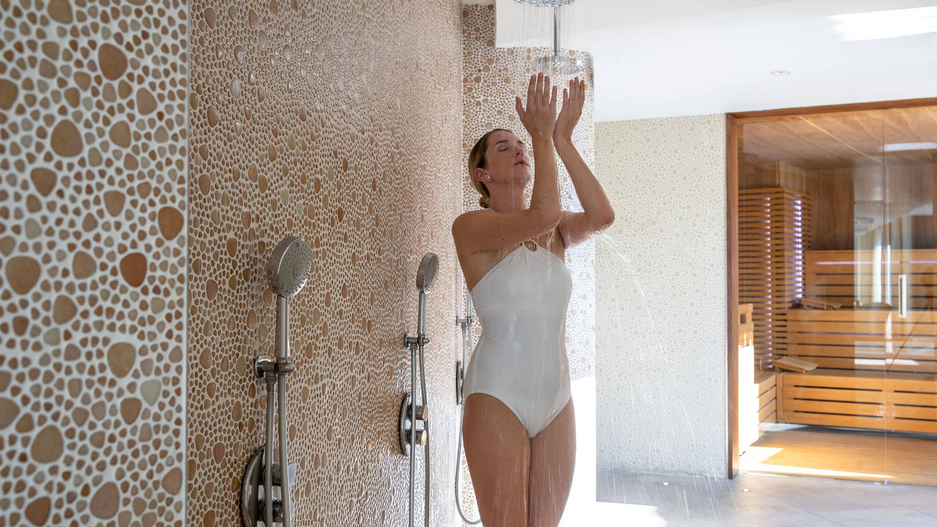 A person taking a shower at a spa