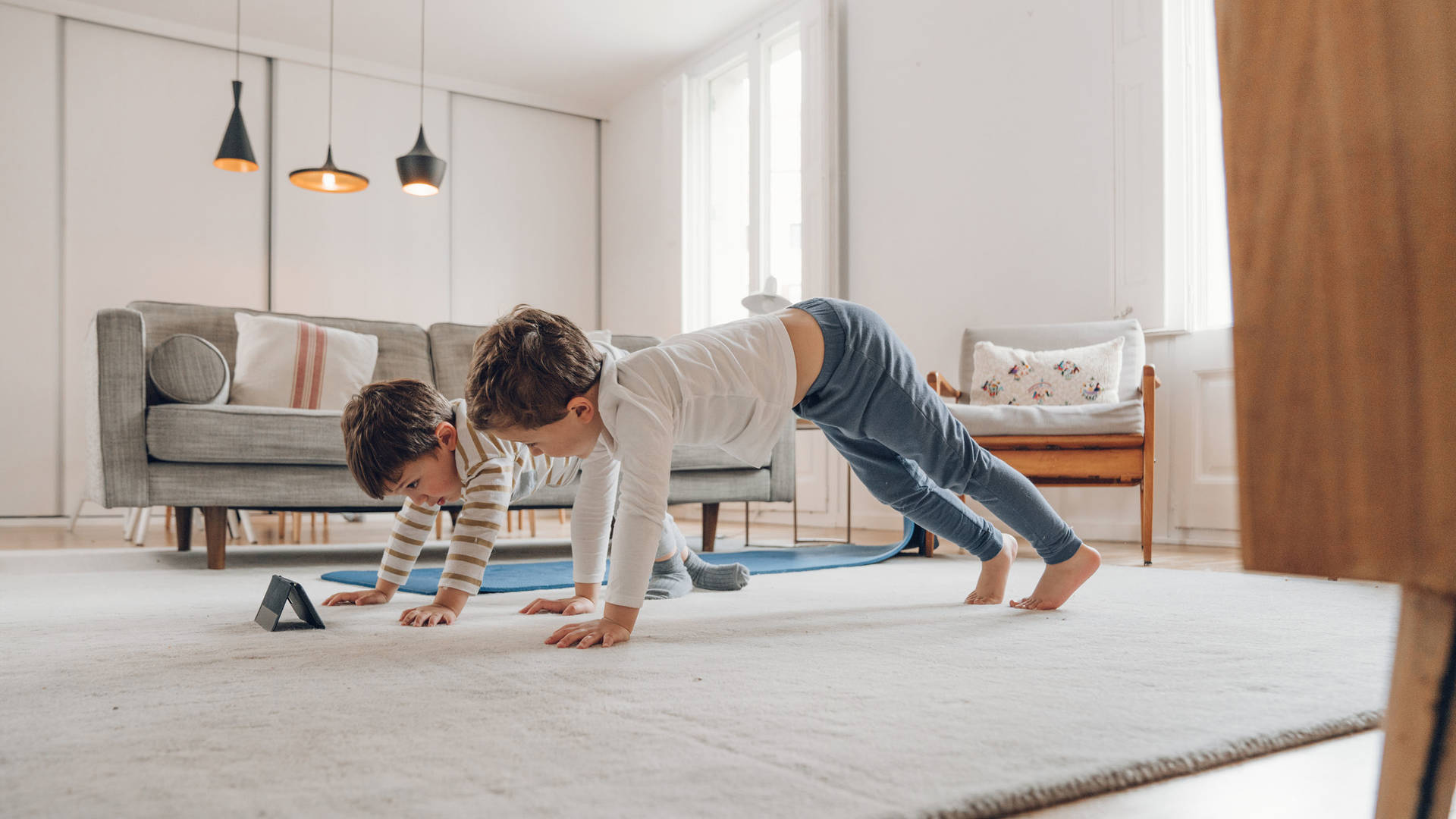 Two children learning yoga poses