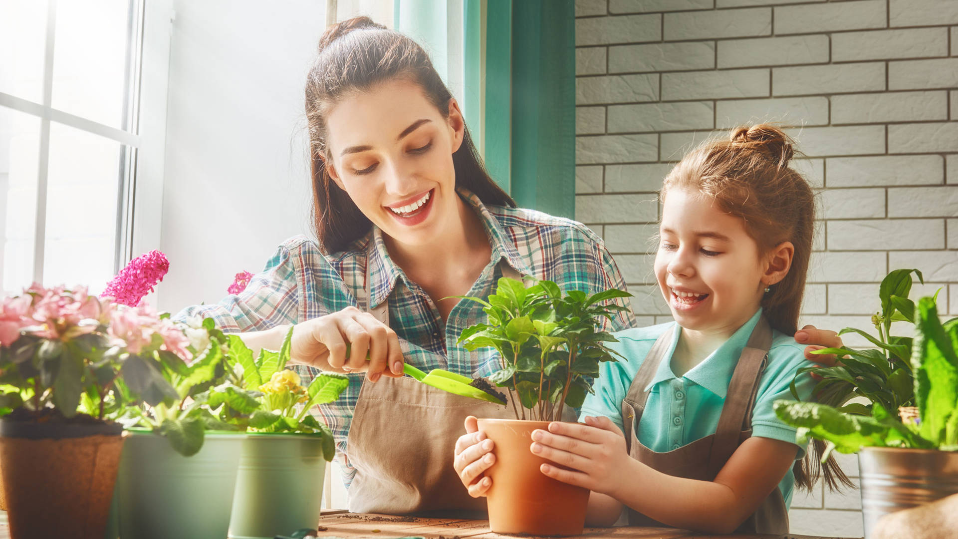 A mother and daughter gardening at home together