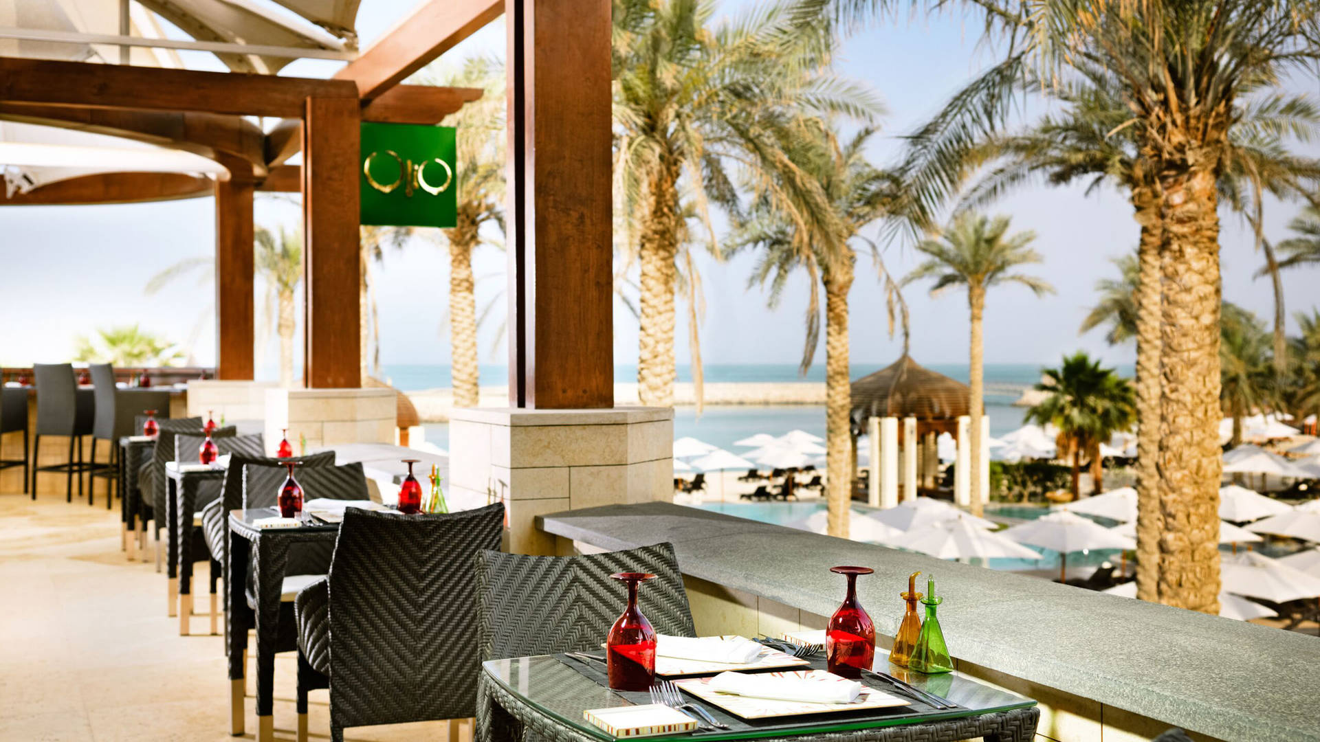 Dining outside at Jumeirah Messilah Beach Hotel
