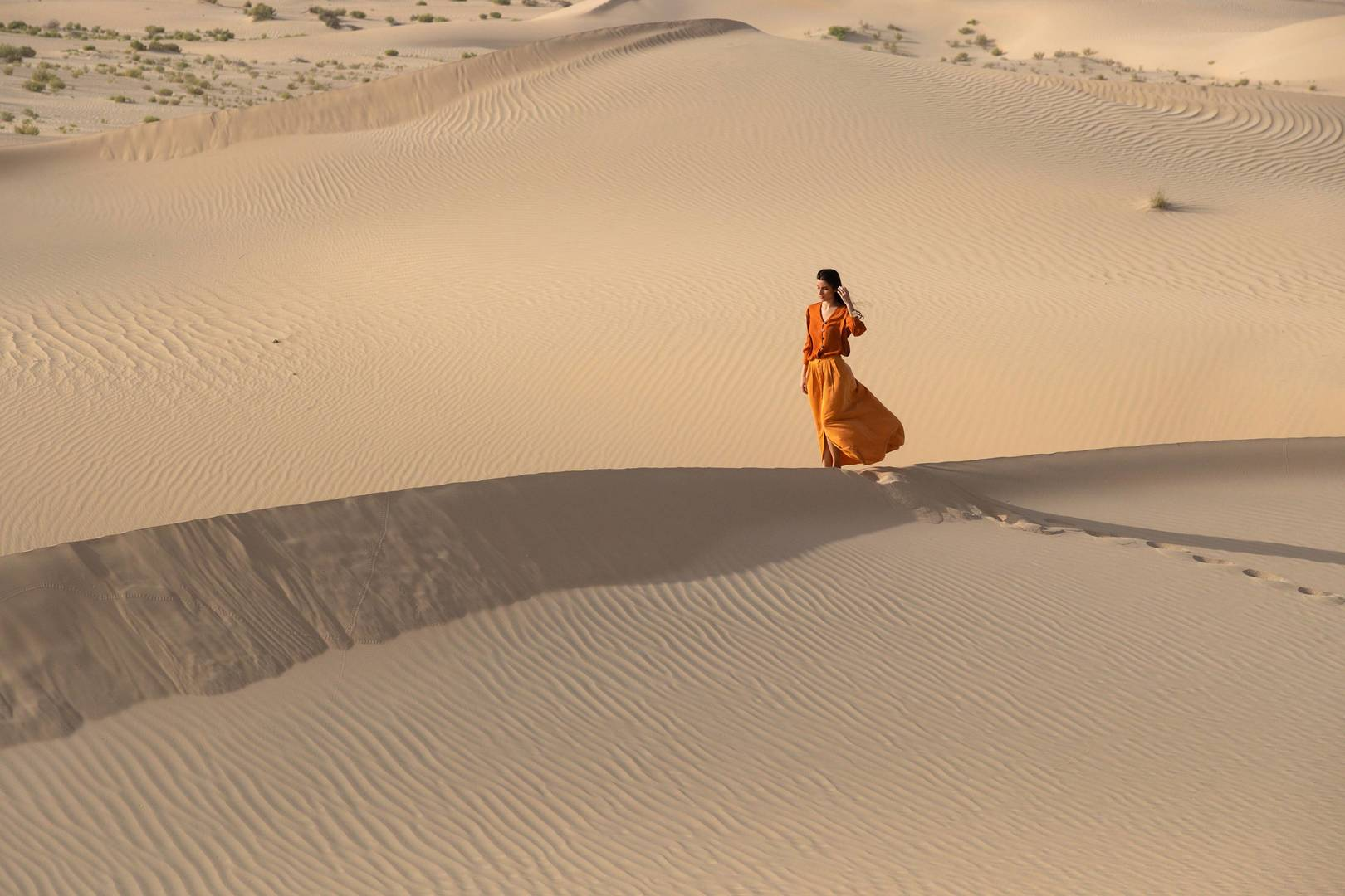Lady walking on a dune