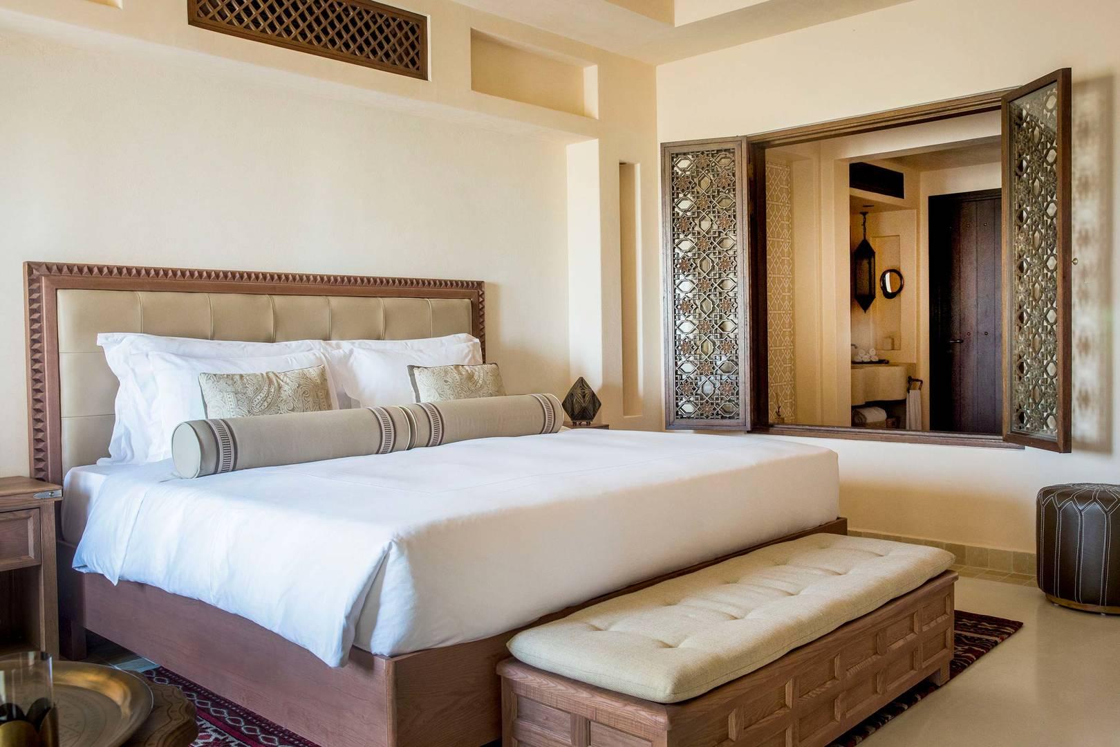Arabian Deluxe Room Bedroom at Jumeirah Al Wathba Desert Resort & Spa