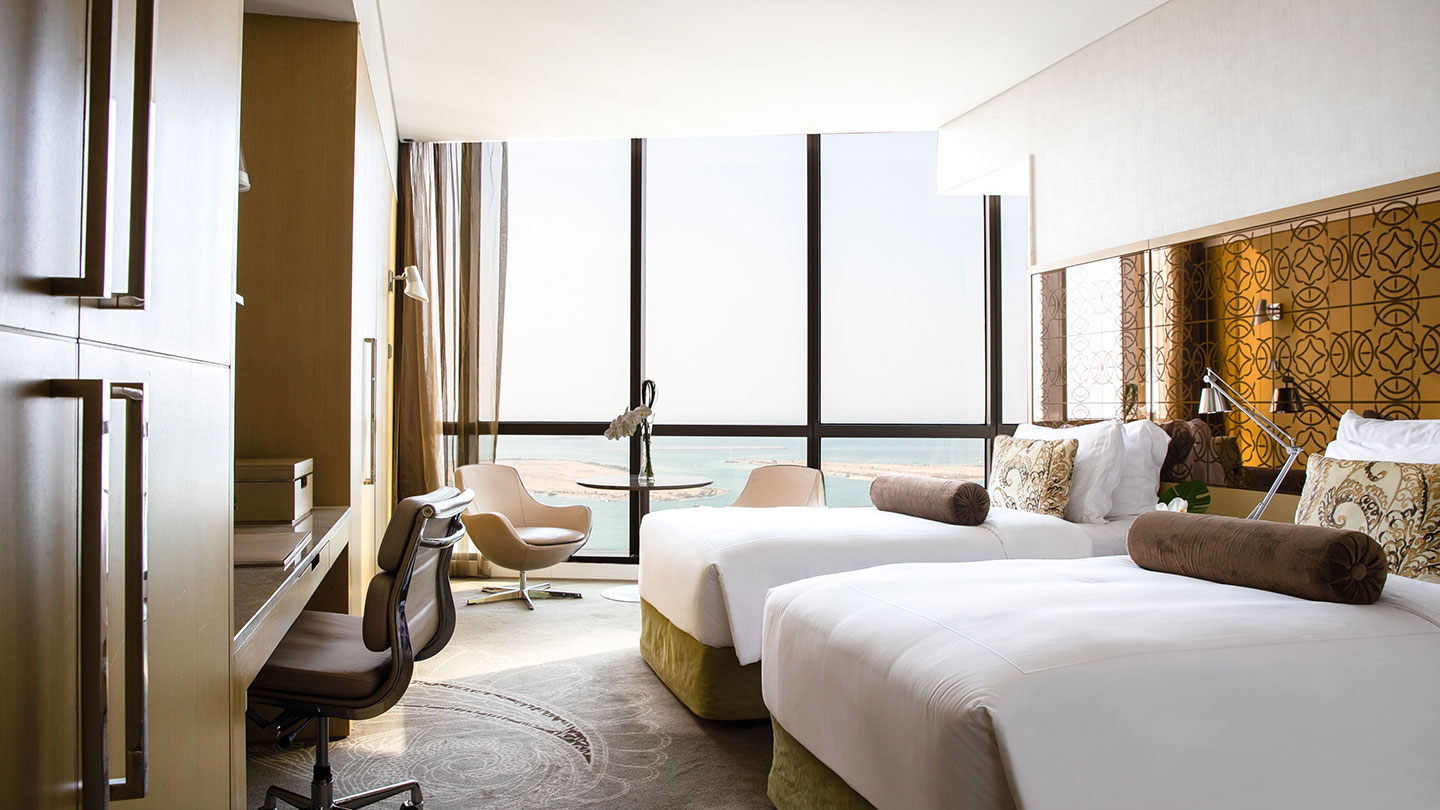 Twin beds with view at Jumeirah at Etihad Towers