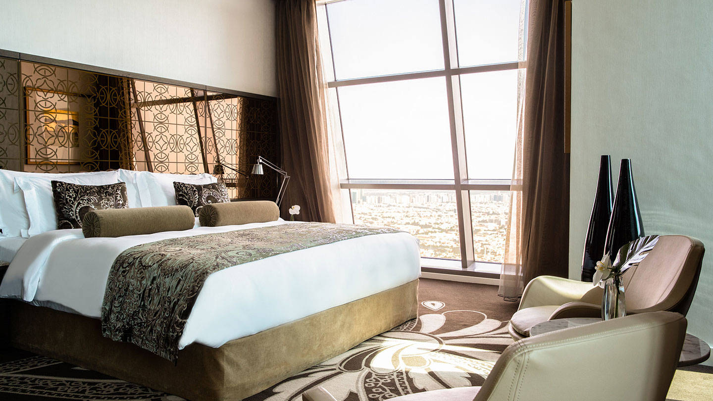 Luxe king bed with view at Jumeirah at Etihad Towers