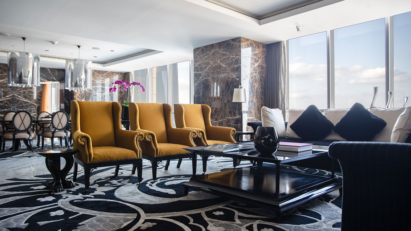 Armchairs in lounge area of vast suite at Jumeirah at Etihad Towers