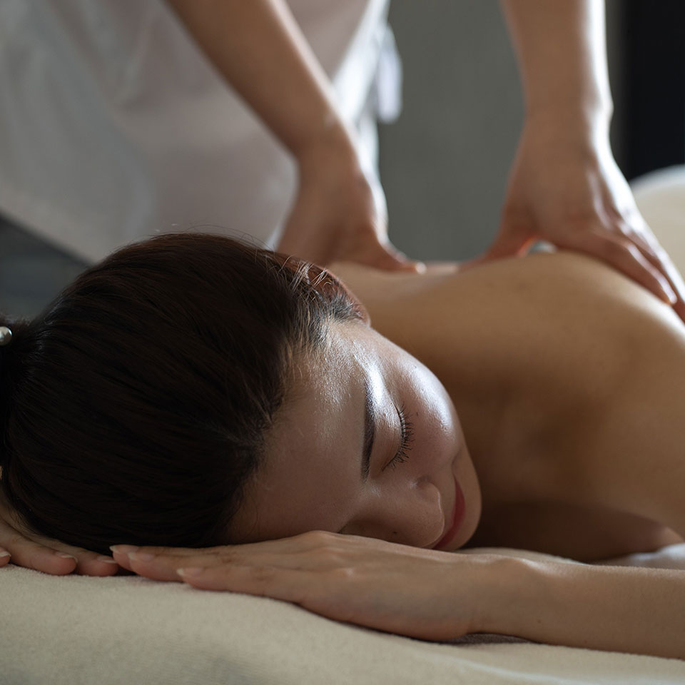 Woman relaxing with back massage